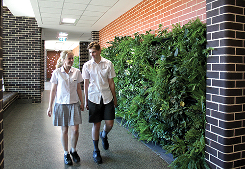Students walking past the indoor garden in the new Dempsey Science Wing