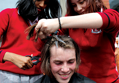 "Students participating in the ""Shave for a Cure Day"" fund-raising event"